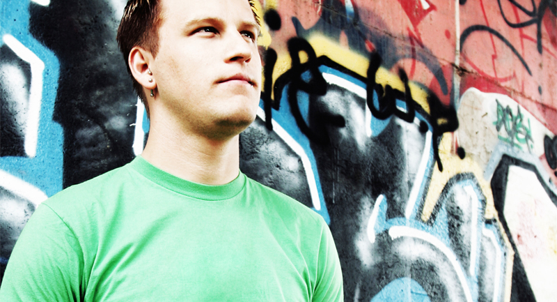 Young male in front of graffiti wall
