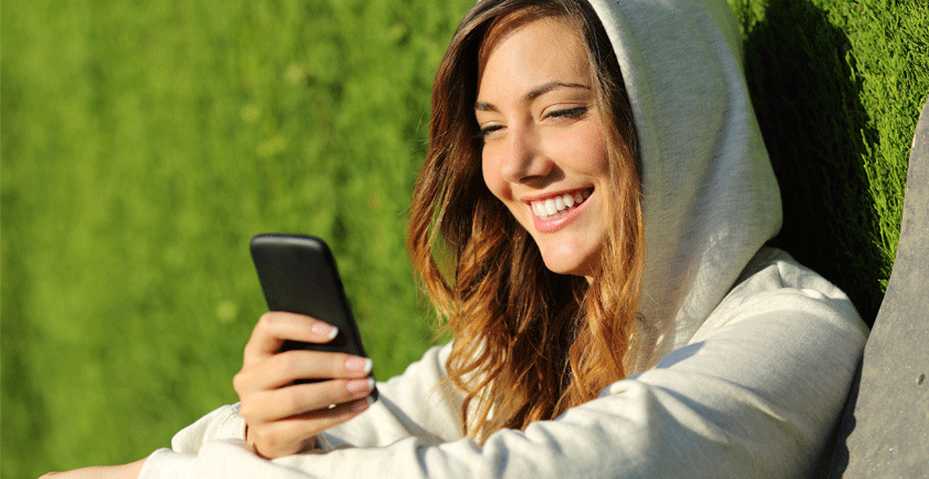 Girl-with-hoodie-on-mobile-phone