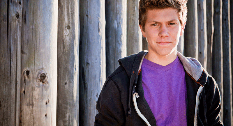 teenage-boy wearing purple-tshirt