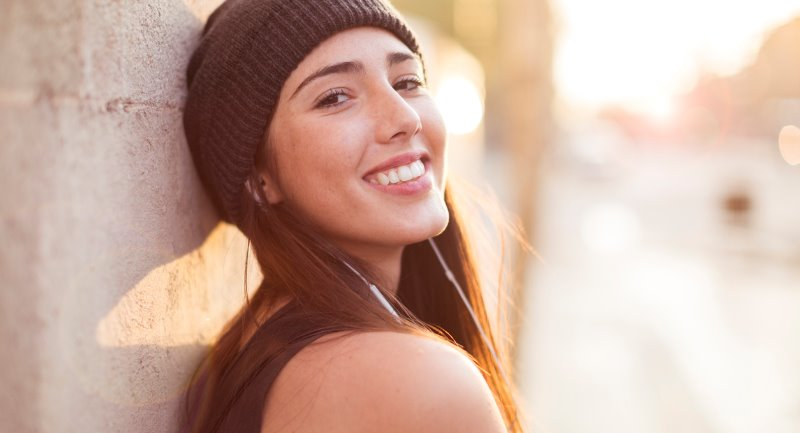 dark haired young lady wearing hat