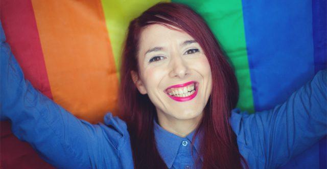 Girl holding rainbow flag