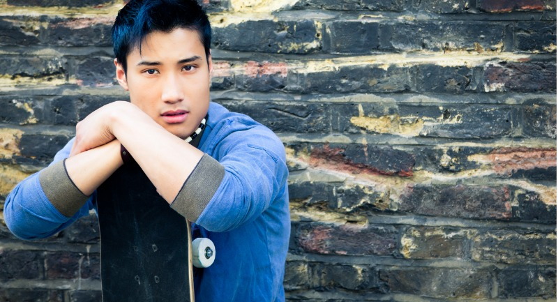 asian-man-with-skateboard