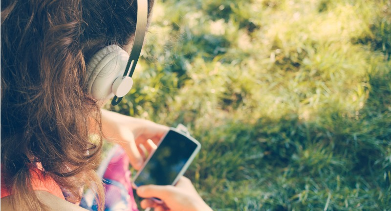 cropped-image-of-a-girl-in-headphones-listen-to-music-picture