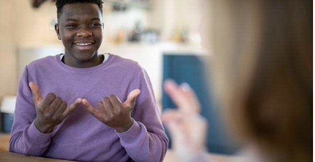 teenage-boy-and-girl-having-conversation-using-sign-language