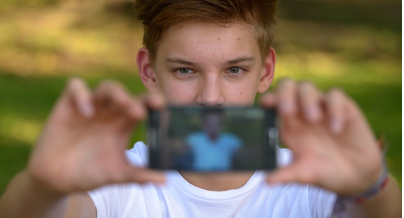 teenager-boy-taking-selfie-with-mobile-phone