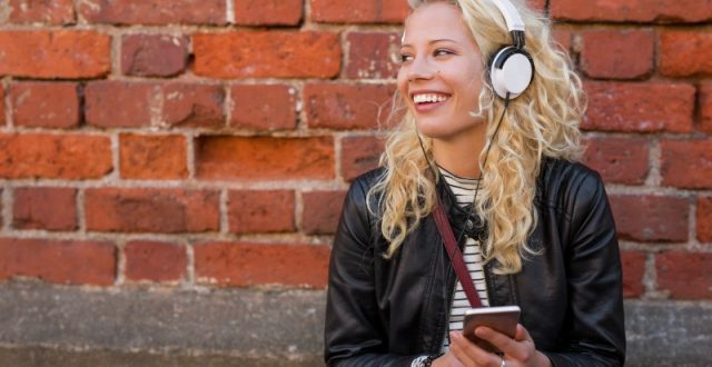 happy-hipster-with-headphones-listening-to-music