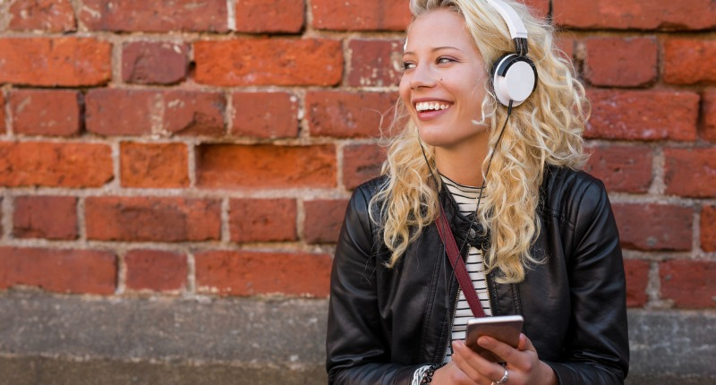 happy-girl-with-headphones-listening-to-music