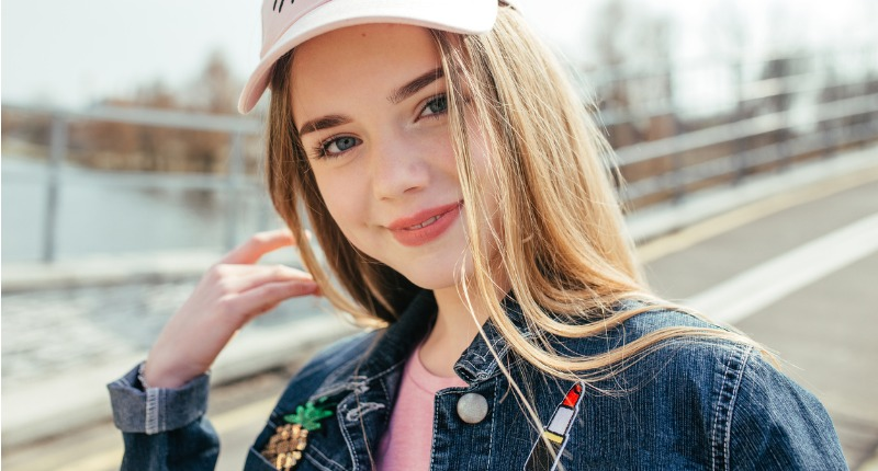 portrait-closeup-beautiful-young-girl-in-pink-hat-in-city-street