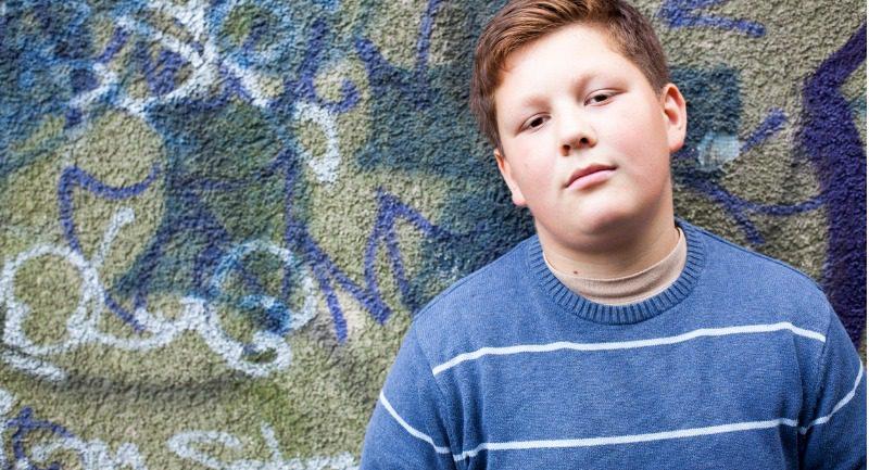 teenage-boy-portrait-in-front-of-graffiti-wall