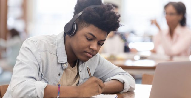 teen-listens-to-music-while-working